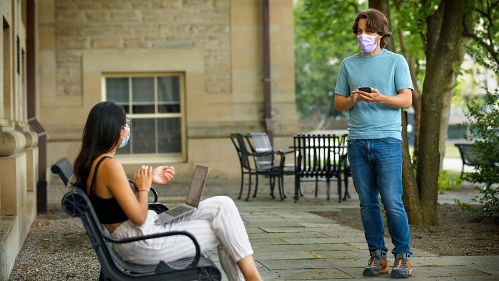In this photo provided by Jason Koski and Cornell University, Bryan Maley, right, a grad student in the Master of Public Health program, interviews a ...