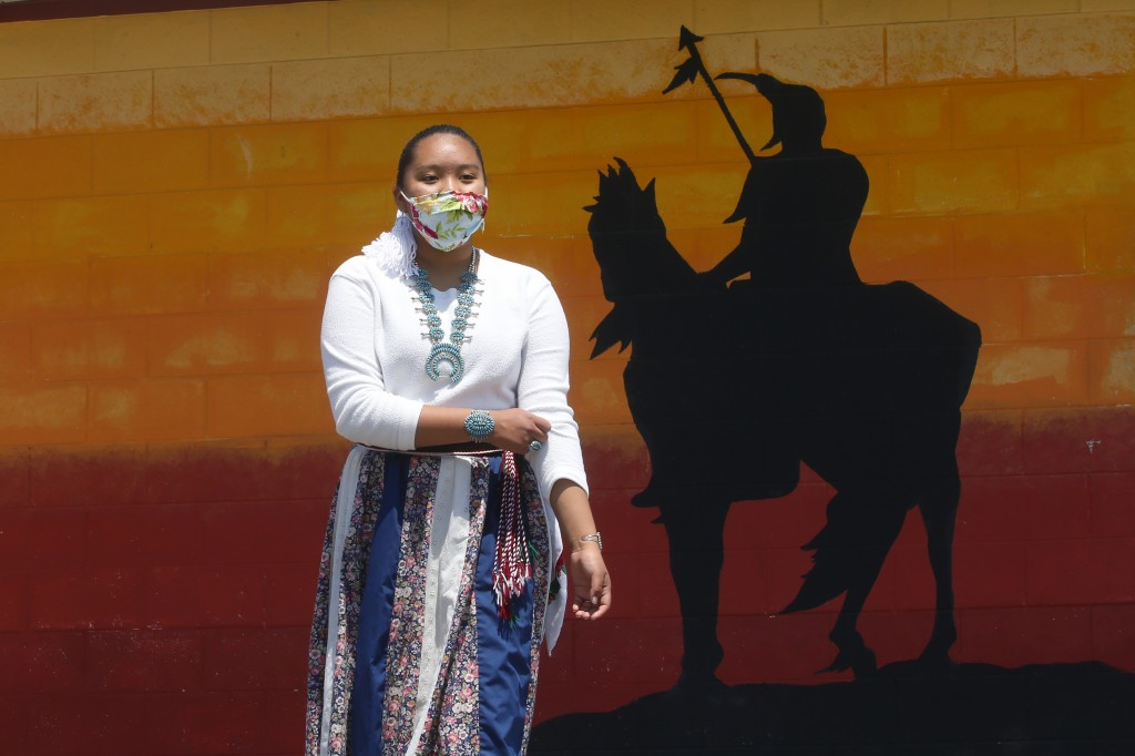 Lemiley Lane, a Bountiful junior who grew up in the Navajo Nation in Arizona, walks along the campus near a a mural of an Indigenous man meant to repr...