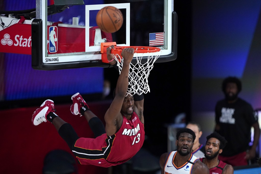 Miami Heat's Bam Adebayo (13) dunks over Phoenix Suns' Deandre Ayton during the second half of an NBA basketball game, Saturday, Aug. 8, 2020 in Lake ...
