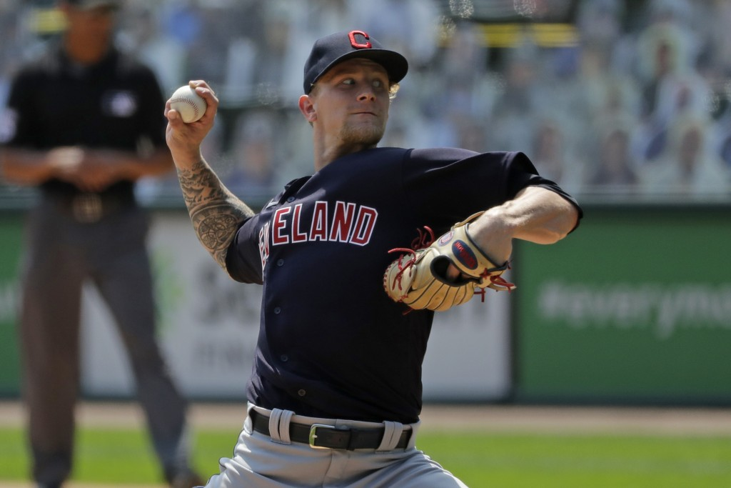 Cleveland Indians starting pitcher Zach Plesac throws against the Chicago White Sox during the first inning of a baseball game in Chicago, Saturday, A...
