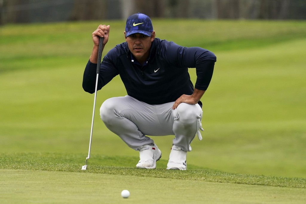 Brooks Koepka lines up a putt on the 13th hole during the third round of the PGA Championship golf tournament at TPC Harding Park Saturday, Aug. 8, 20...