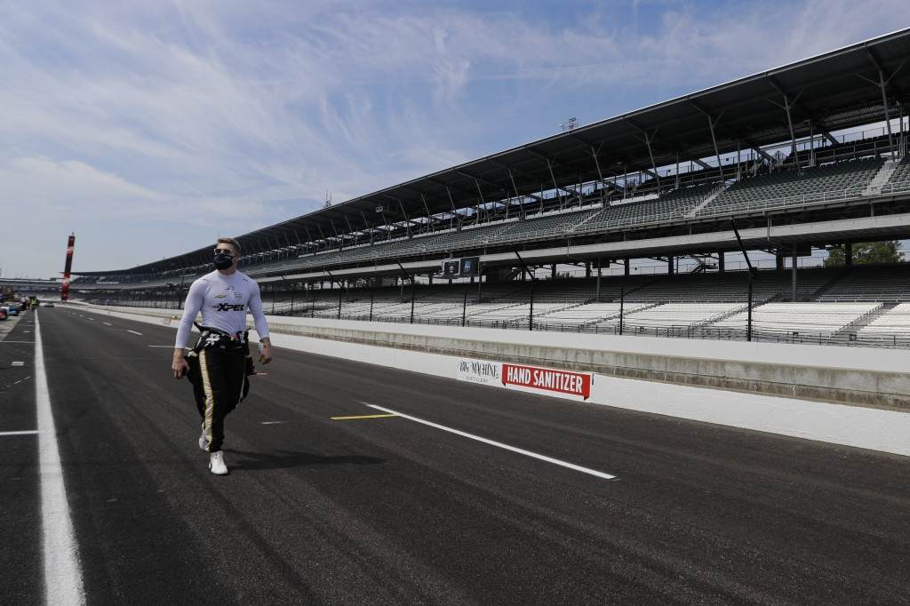 FILE - In this July 30, 2020, file photo, race driver Josef Newgarden walks through the pit area before the start of practice for an IndyCar auto race...