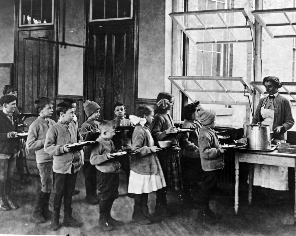 This 1900 photo from the Library of Congress photo shows schoolchildren waiting for lunch at open air school, PS 51, in New York. Poor ventilation in ...