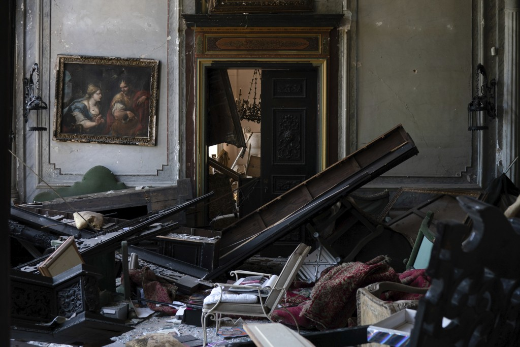 A painting hangs on the wall of a heavily damaged room in the Sursock Palace after the explosion in the seaport of Beirut, Lebanon, Saturday, Aug. 8, ...