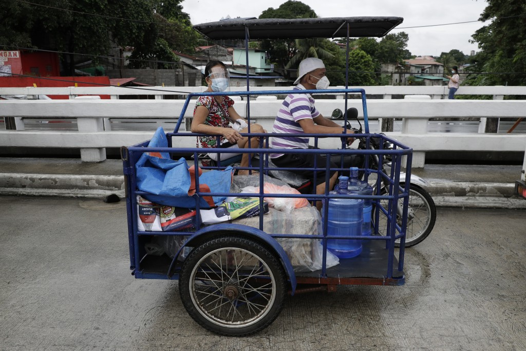 Residents transport pandemic suppliesonborder of Bulacan province and Caloocan City, Manila, Philippines on Aug. 10.