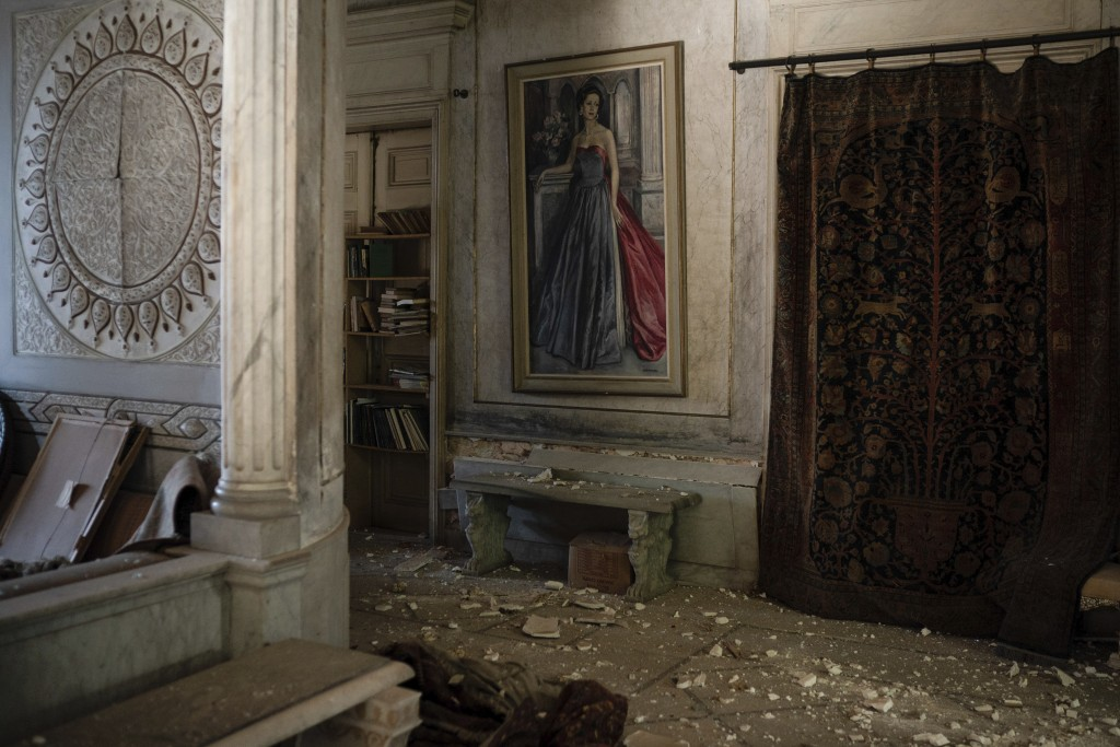 Debris from the ceiling and walls cover the floor of a room in the Sursock Palace, heavily damaged after the explosion in the seaport of Beirut, Leban...