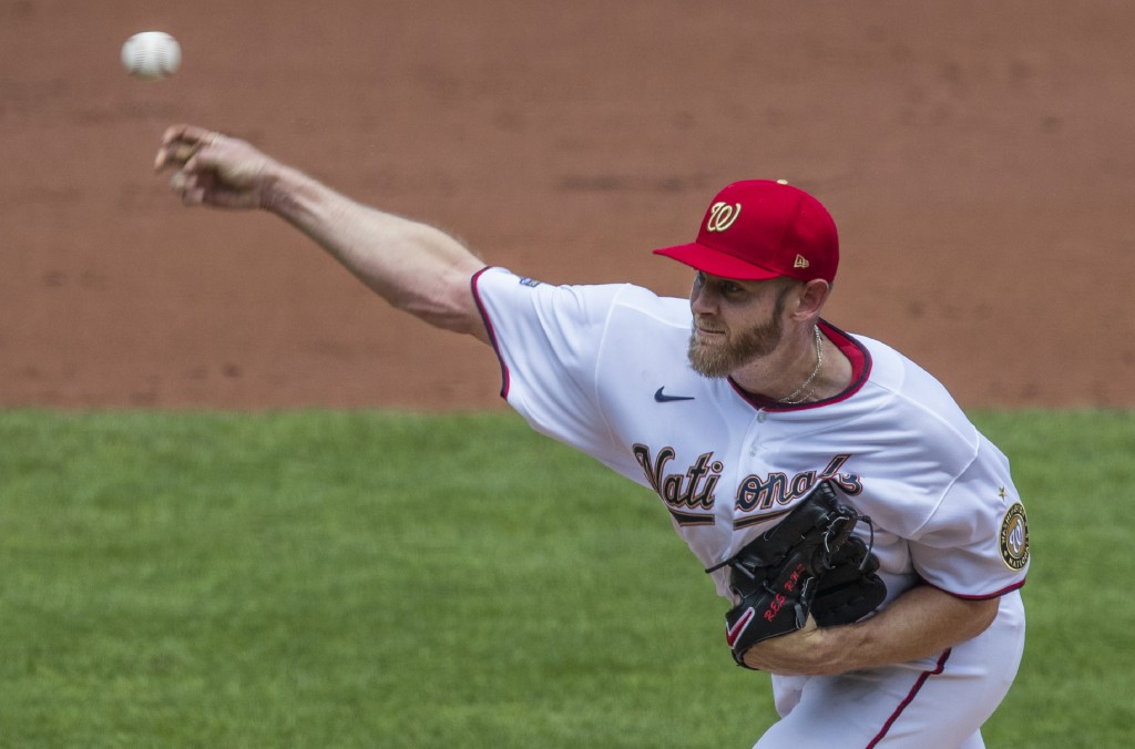Washington Nationals starting pitcher Stephen Strasburg throws during the second inning of a baseball game against the Baltimore Orioles in Washington...