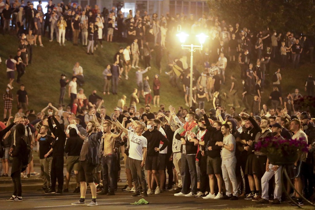 """Protesters shout """"Go away!"""" as they gather after the Belarusian presidential election in Minsk, Belarus, Sunday, Aug. 9, 2020. Belarus police and prot..."""