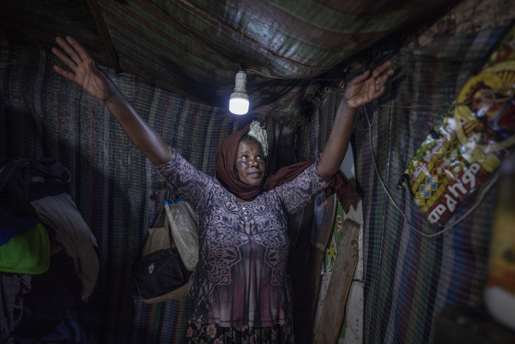 Mother of two Amsale Hailemariam, a domestic worker who lost work because of the coronavirus, stands in her small tent in the capital Addis Ababa, Eth...