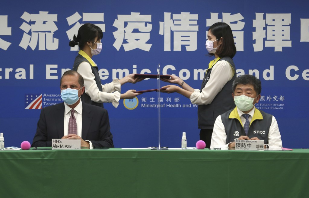 U.S. Health and Human Services Secretary Alex Azar, seated left, and Taiwanese Minister of Health and Welfare Chen Shih-chung sign a contract during a...