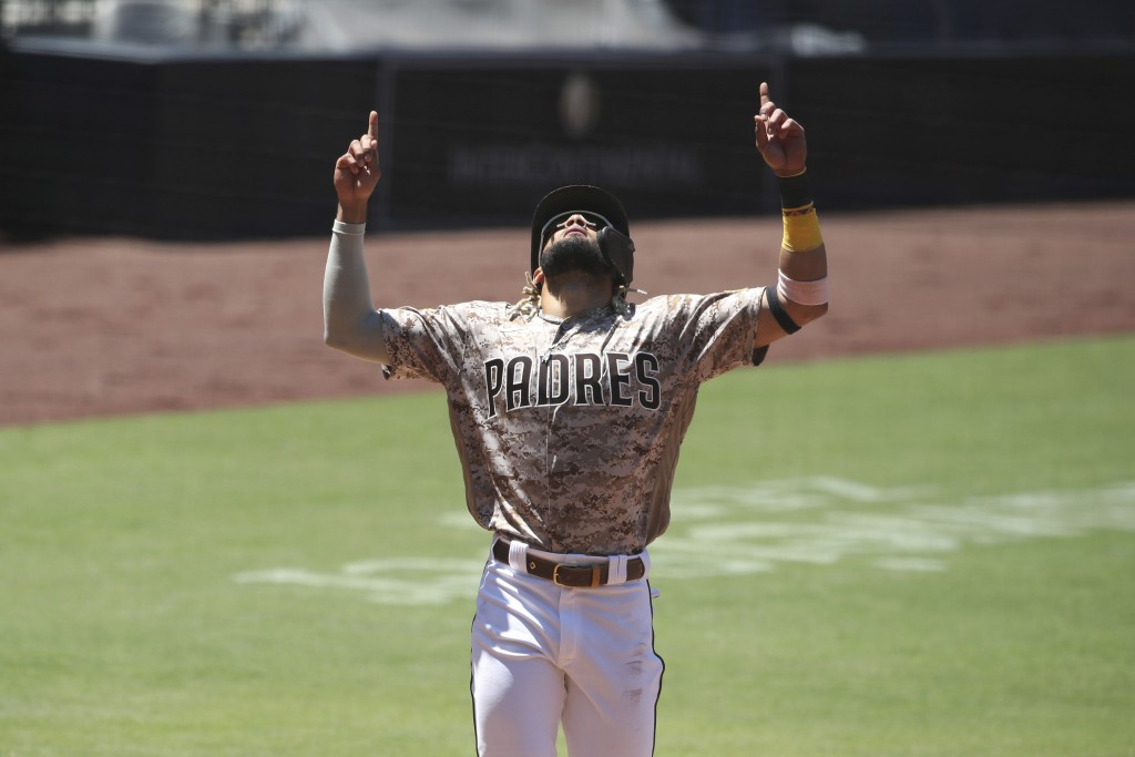 San Diego Padres Fernando Tatis Jr. celebrates as he crosses home plate after hitting a home run against the Arizona Diamondbacks in the second inning...
