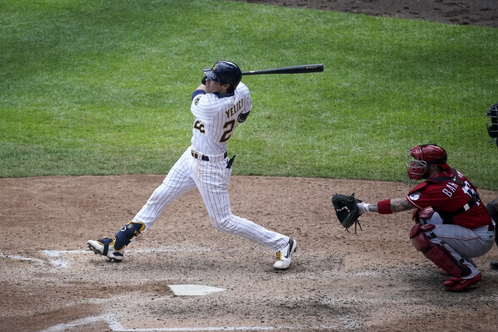 Milwaukee Brewers' Christian Yelich hits a home run during the seventh inning of a baseball game Sunday, Aug. 9, 2020, in Milwaukee. (AP Photo/Morry G...