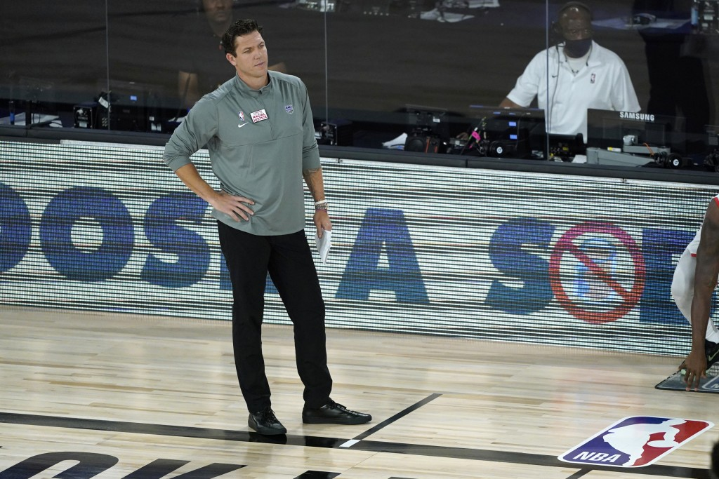 Sacramento Kings head coach Luke Walton watches during the first half of an NBA basketball game against the Houston Rockets, Sunday, Aug. 9, 2020, in ...