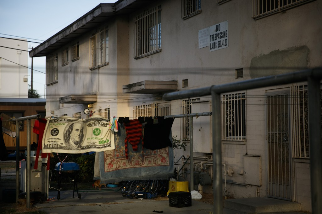 Laundry hangs on a clothesline outside an apartment building at the Jordan Downs housing project in the Watts neighborhood of Los Angeles, Monday, Jun...