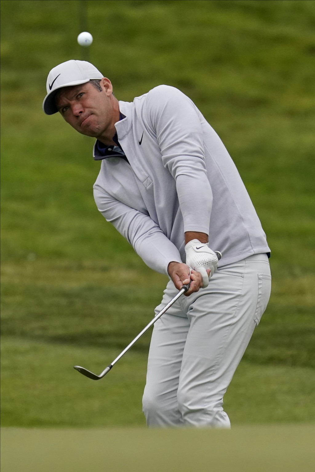 Paul Casey of England, chips to the green on the 13th hole during the final round of the PGA Championship golf tournament at TPC Harding Park Sunday, ...