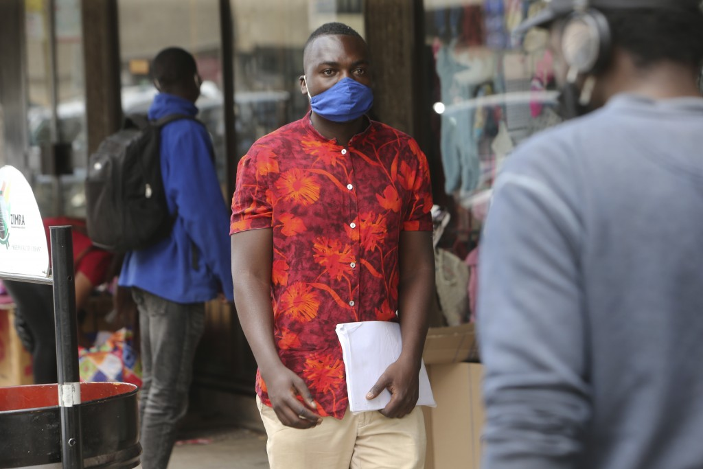 Emmanuel Reyai walks on the streets of Harare while looking for a job, Wednesday, Aug, 5, 2020. Around the world, young people armed with new degrees,...