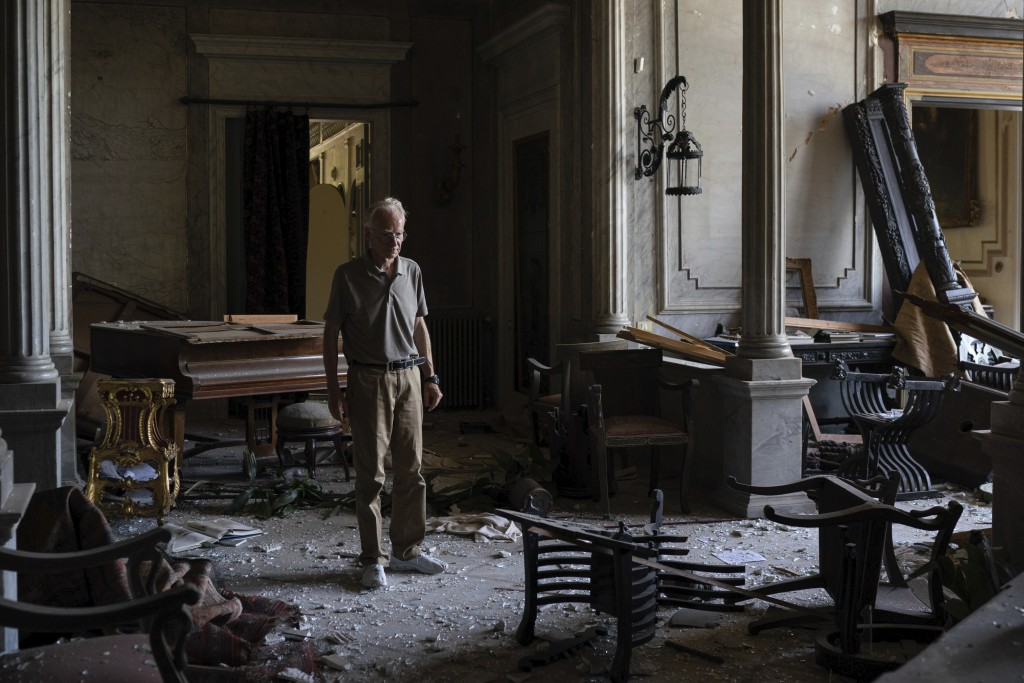 Roderick Sursock stands in a heavily damaged room of the Sursock Palace, affected by the explosion in the seaport of Beirut, Lebanon, Saturday, Aug. 8...