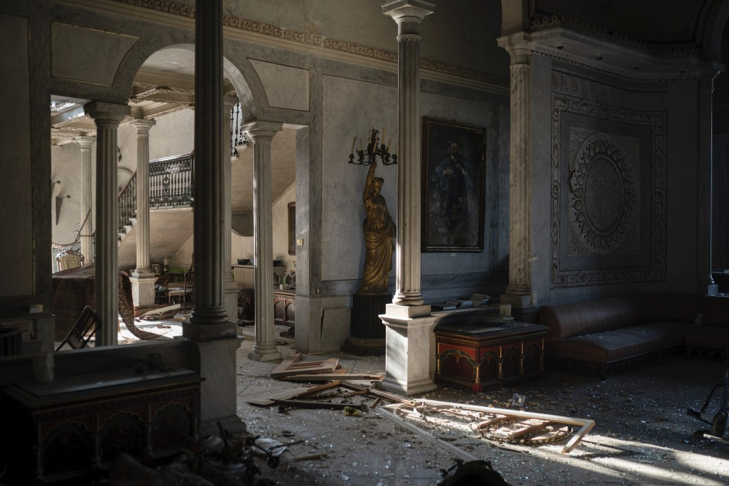 Broken glass and window frames lay on the floor of the Sursock Palace, heavily damaged after the explosion in the seaport of Beirut, Lebanon, Friday, ...
