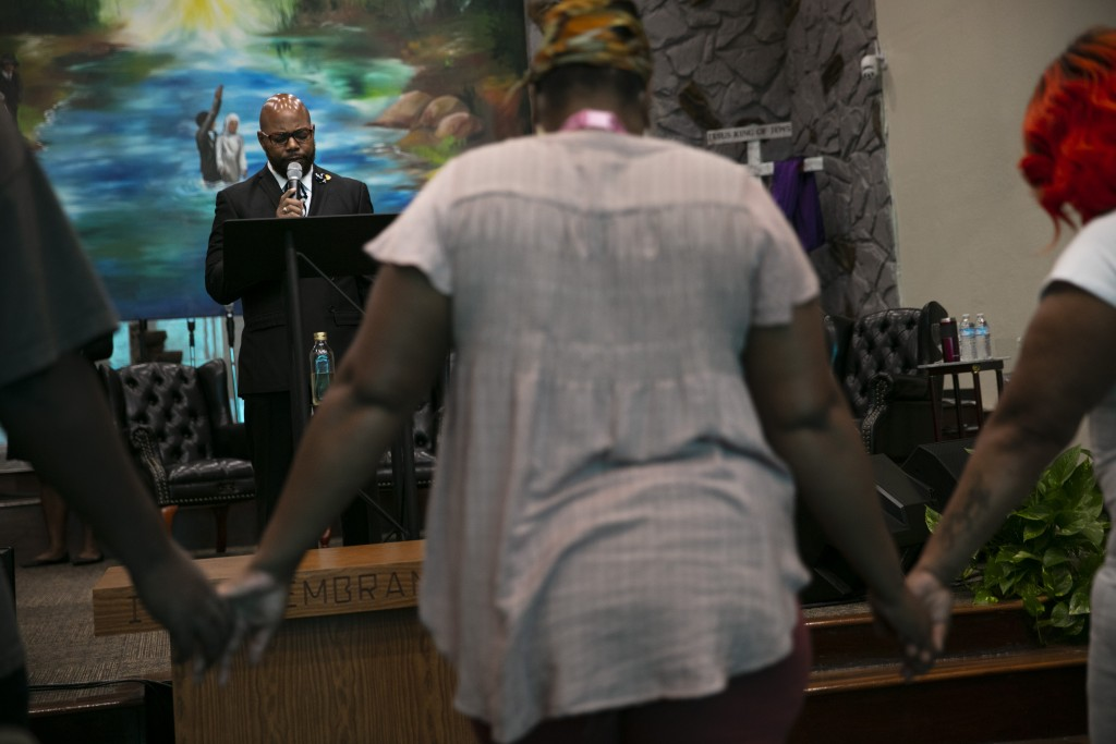 The Rev. Marcus Murchinson leads a prayer during a Sunday service at Tree of Life Missionary Baptist Church Sunday, June 21, 2020, in the Watts neighb...