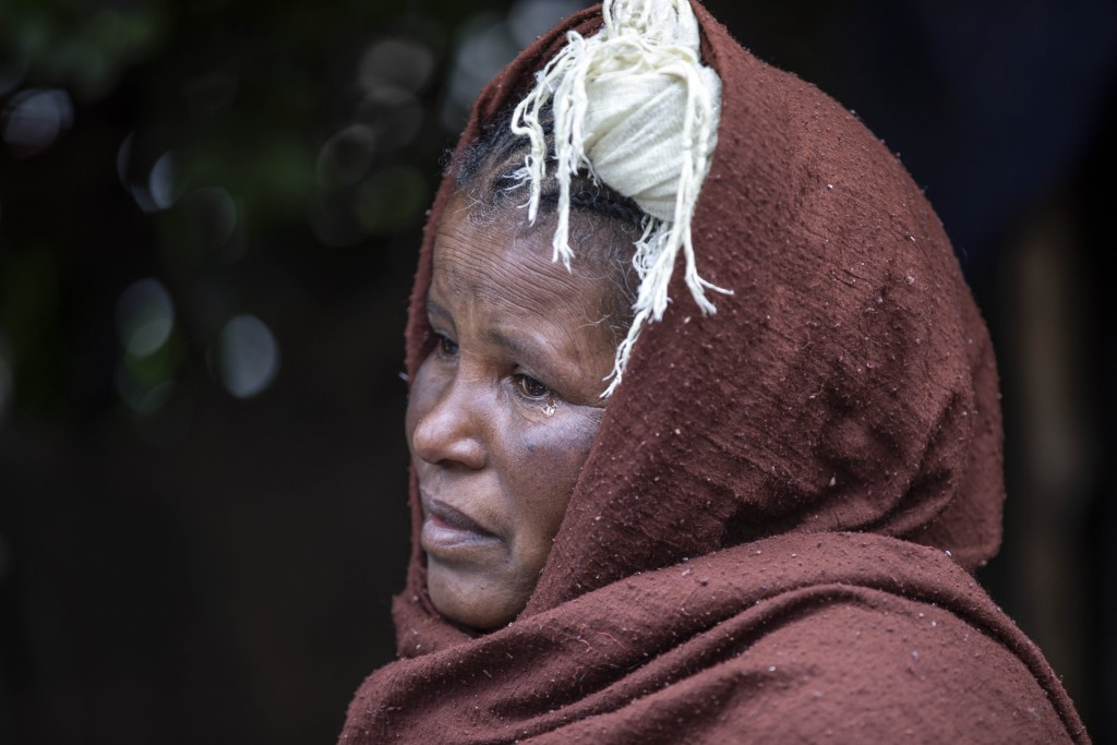 Mother of two Amsale Hailemariam, a domestic worker who lost work because of the coronavirus, sheds a tear as she speaks during an interview in the ca...