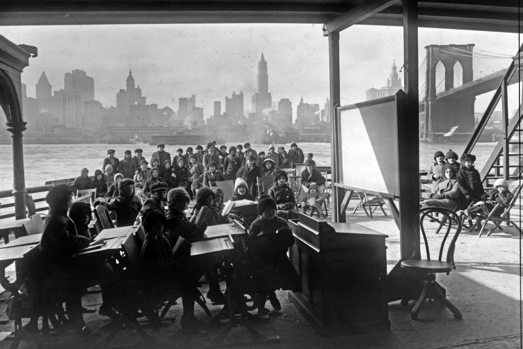 This 1911 photo from the Library of Congress shows schoolchildren on the ferry boat Rutherford, across the river from Manhattan, and near the Brooklyn...