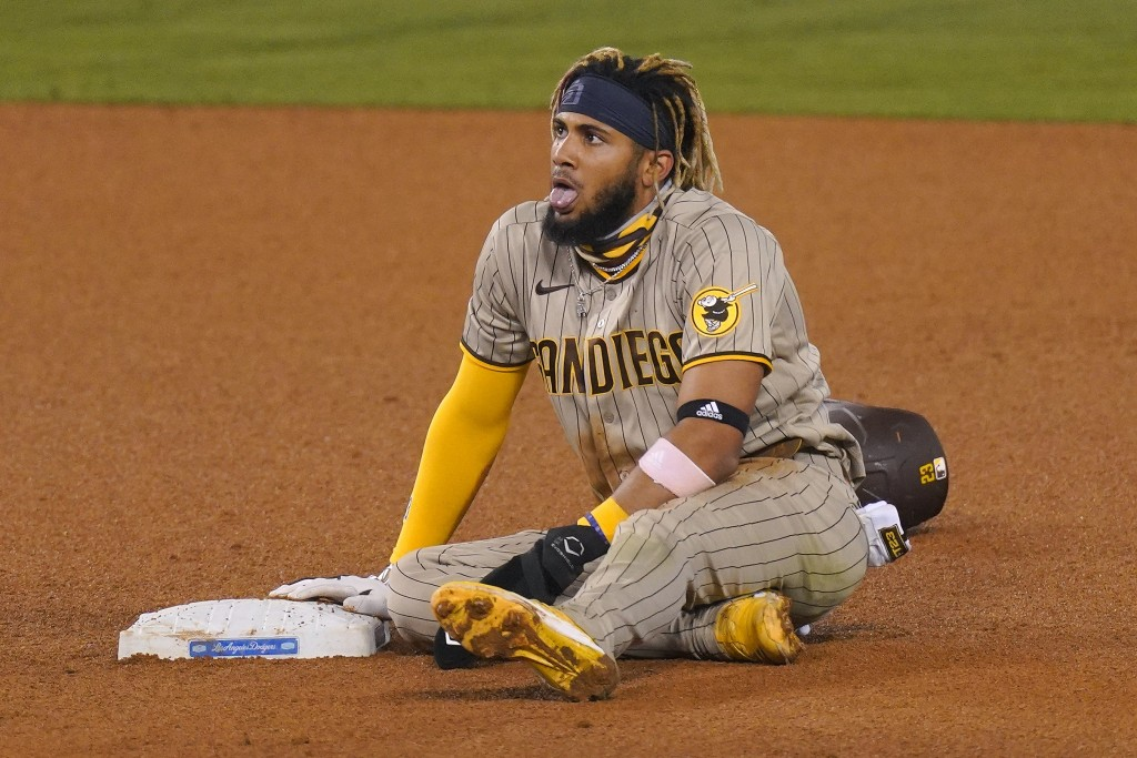 San Diego Padres' Fernando Tatis Jr. takes a breather after stealing second during the eighth inning of a baseball game against the Los Angeles Dodger...
