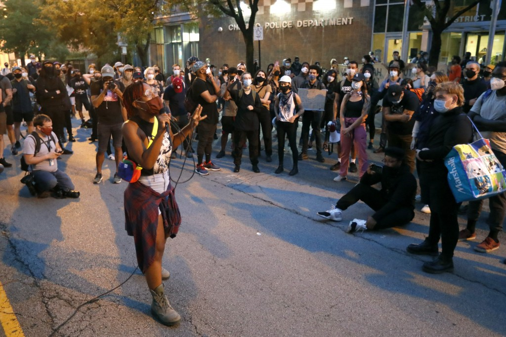Ariel Atkins, a lead organizer for Black Lives Matter Chicago, leads a protest Monday, Aug. 10, 2020, outside the Chicago Police Department's District...
