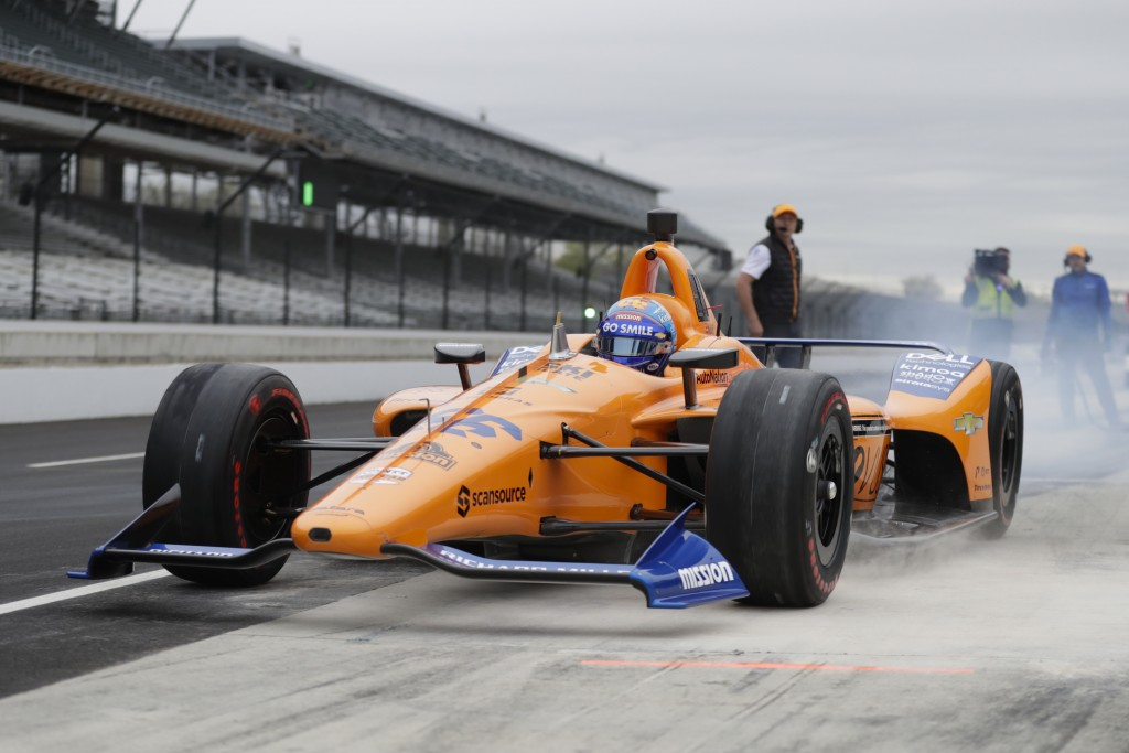 FILE - In this April 24, 2019, file photo, IndyCar driver Fernando Alonso, of Spain, drives out of the pit area during testing at the Indianapolis Mot...