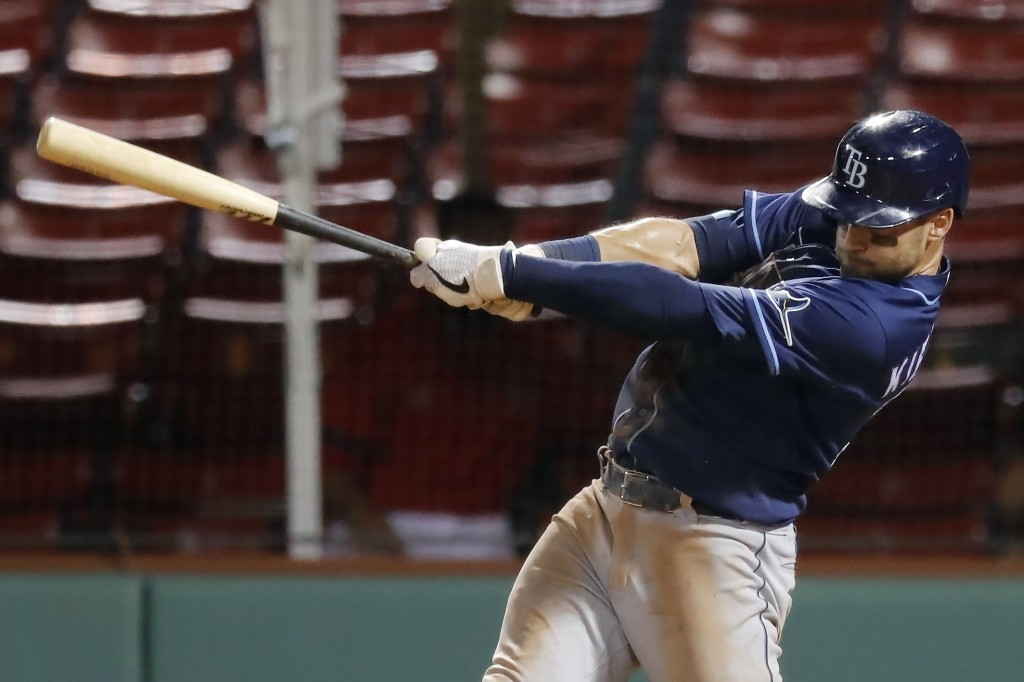 Tampa Bay Rays' Kevin Kiermaier follows through on his two-run double during the seventh inning of a baseball game against the Boston Red Sox, Monday,...