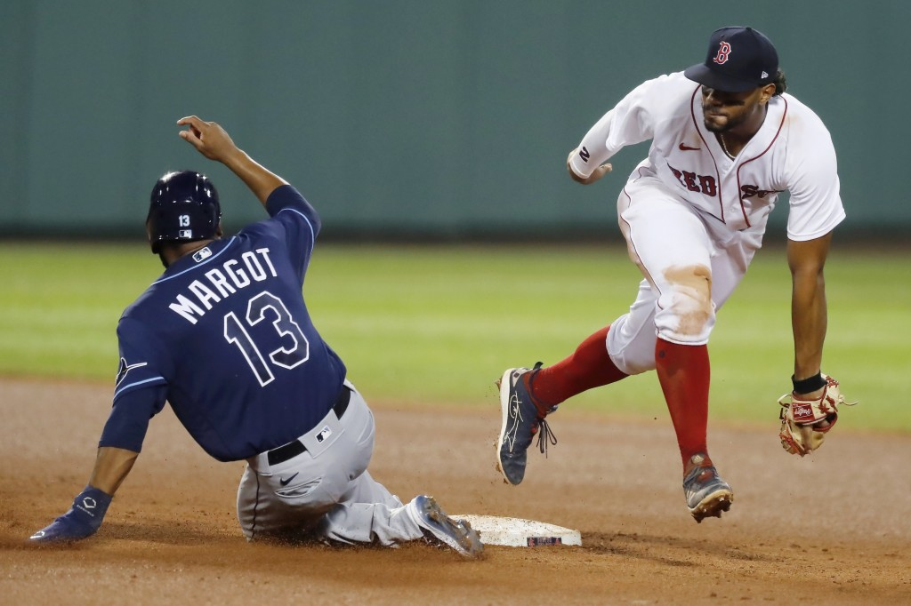 Boston Red Sox's Xander Bogaerts makes the force out at second base on Tampa Bay Rays' Manuel Margot (13) during the fourth inning of a baseball game,...