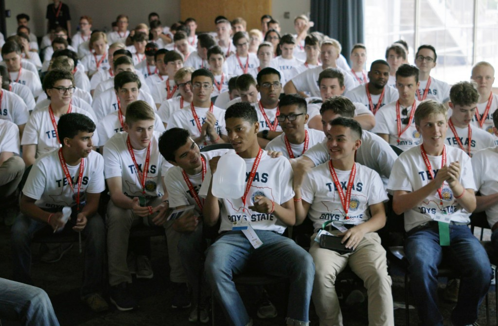 """This image released by A24 shows René Otero, center, in a scene from """"Boys State."""" (A24 via AP)"""