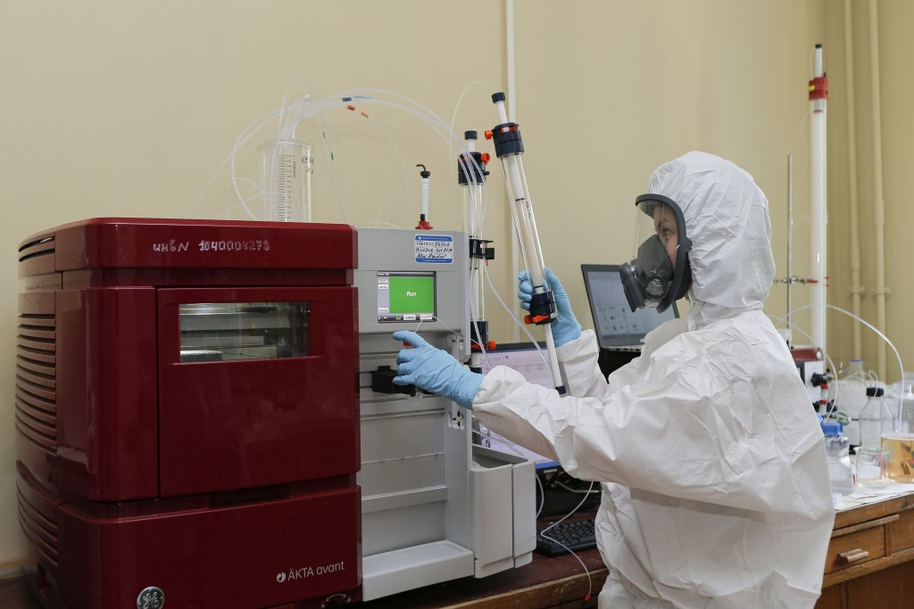 In this handout photo taken on Thursday, Aug. 6, 2020, and provided by Russian Direct Investment Fund, a new vaccine is on display at the Nikolai Gama...