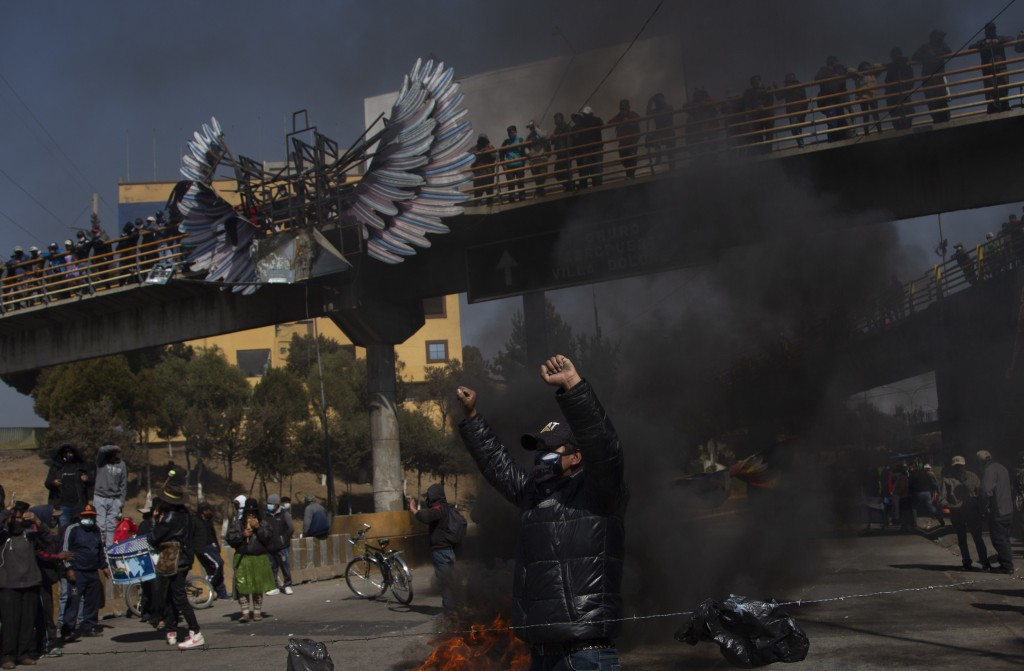 People protest the postponement of the presidential election in El Alto, Bolivia, Monday, Aug.10, 2020. Citing the ongoing new coronavirus pandemic, B...