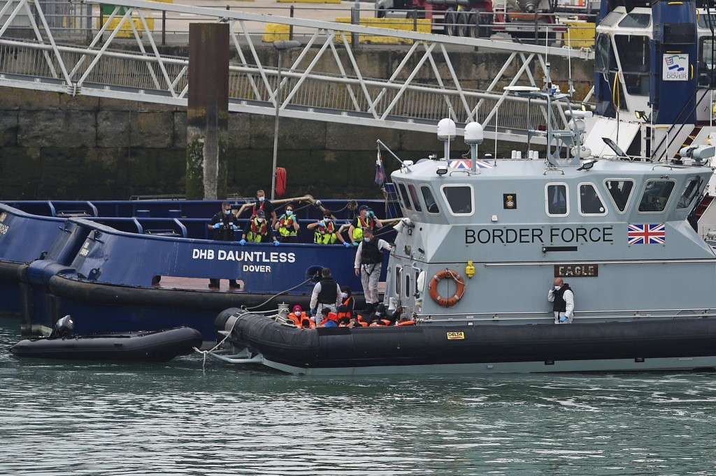 A group of people thought to be migrants are brought into Dover, England, Wednesday Aug. 12, 2020, by Border Force officers. (Kirsty O'Connor/PA via A...
