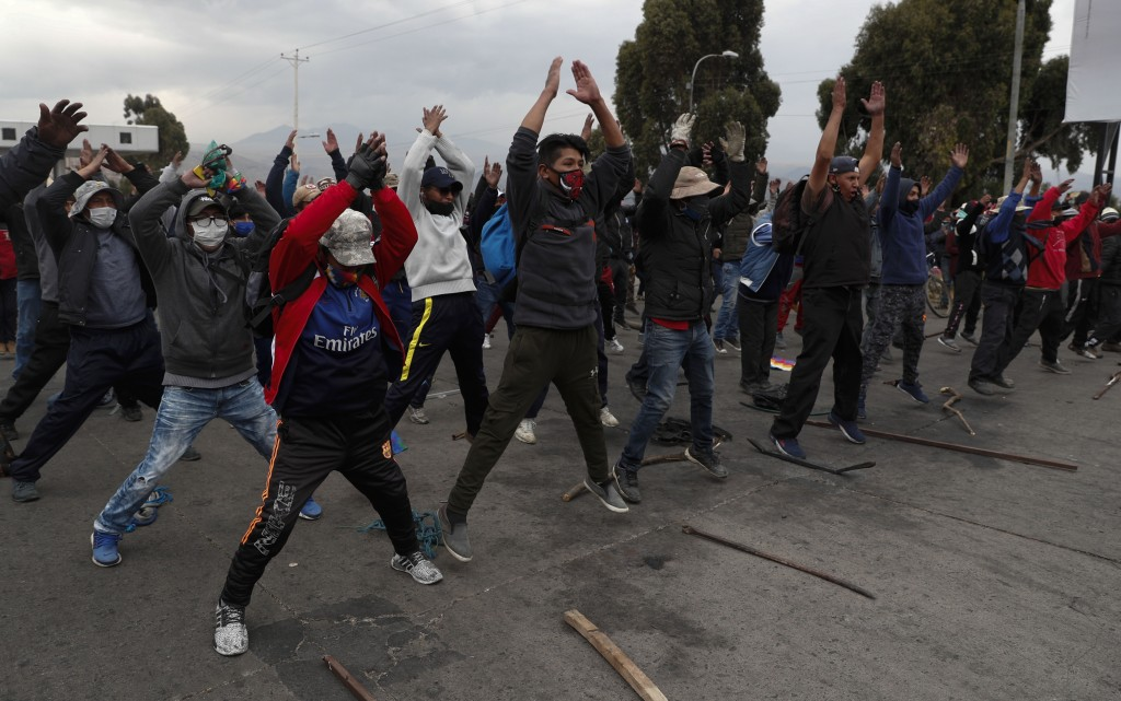 Demonstrators wearing face masks amid the COVID-19 pandemic, protest against the postponement of the presidential election in El Alto, Bolivia, Tuesda...