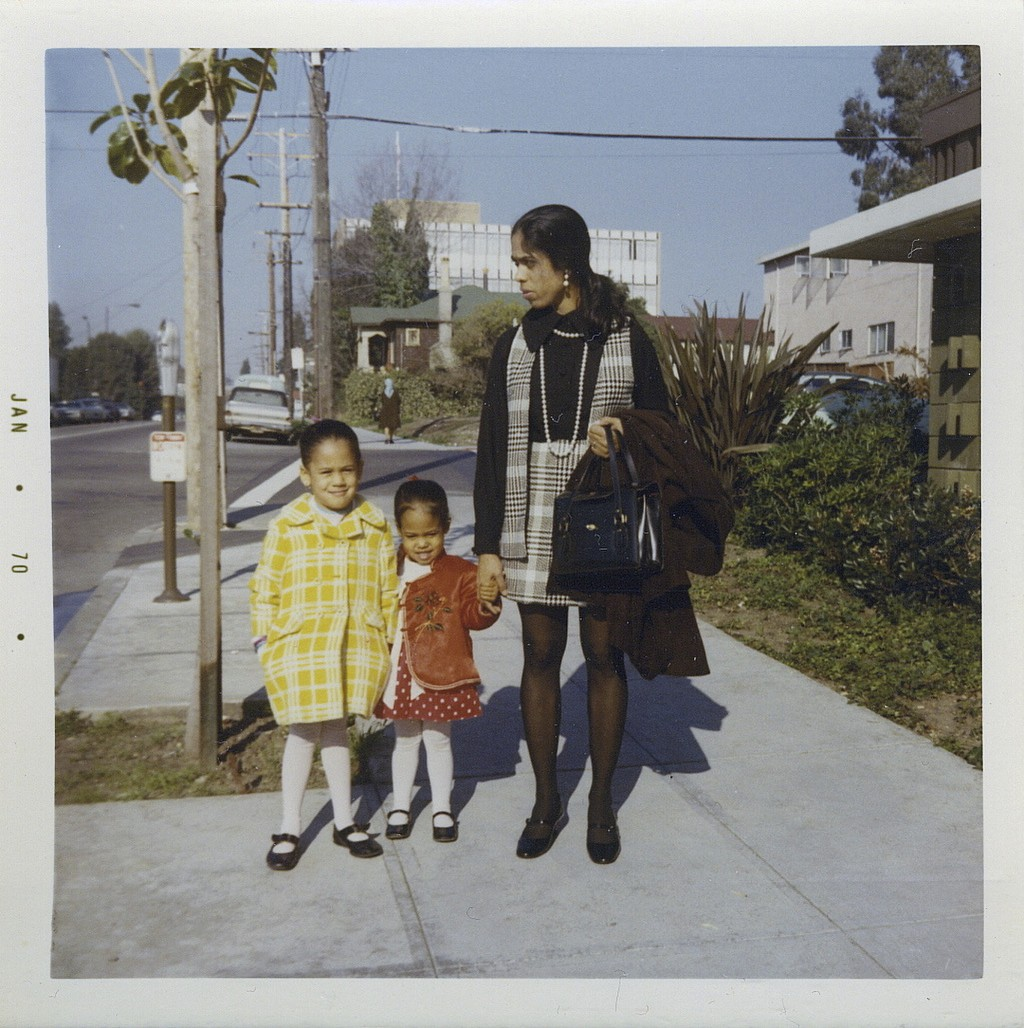 This January 1970 photo provided by the Kamala Harris campaign shows her, left, with her sister, Maya, and mother, Shyamala, outside their apartment i...