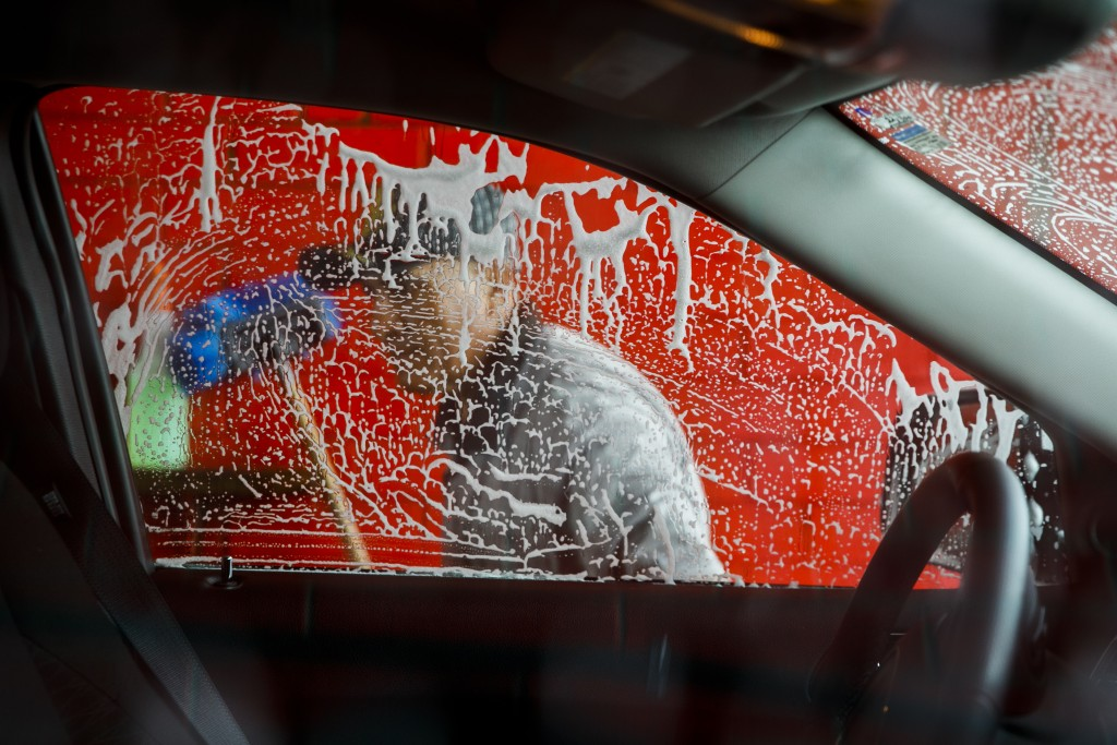 Vivas Hand Car Wash owner Telesforo Vivas, of Sanford N.C., who has been in business for 5 years, washes a car window, in Burlington, N.C., Wednesday,...
