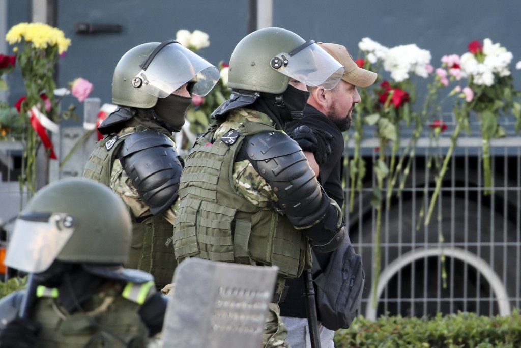 Police detain an opposition supporter protesting the election results as protesters encountered aggressive police tactics in the capital of Minsk, Bel...