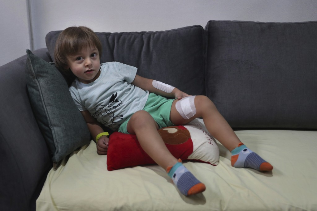 CORRECTS THE FAMILY NAME OF THE BOY - Three-year-old Abed Itani lies on a sofa at his family house in Beirut, Lebanon, Tuesday, Aug. 11, 2020. Abed wa...