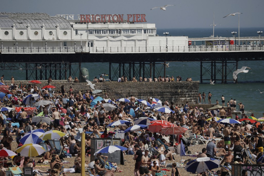 FILE - In this file photo dated Wednesday, June 24, 2020, large numbers of people relax on the beach in Brighton, England. The British government insi...