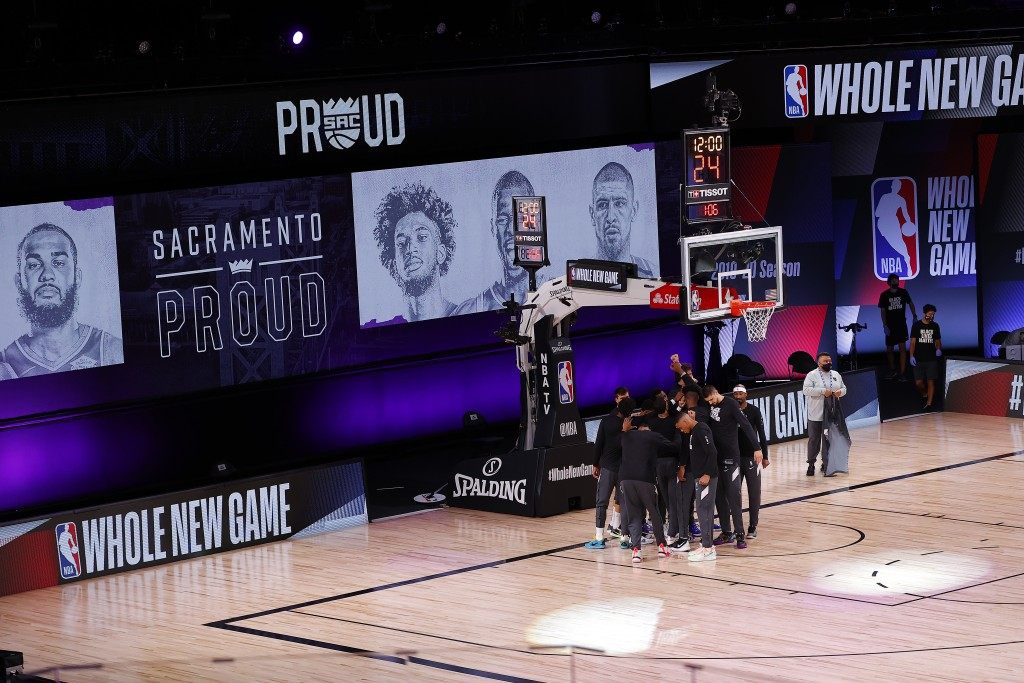 The Sacramento Kings take the court against the New Orleans Pelicans prior to the start of the game of an NBA basketball game Tuesday, Aug. 11, 2020, ...