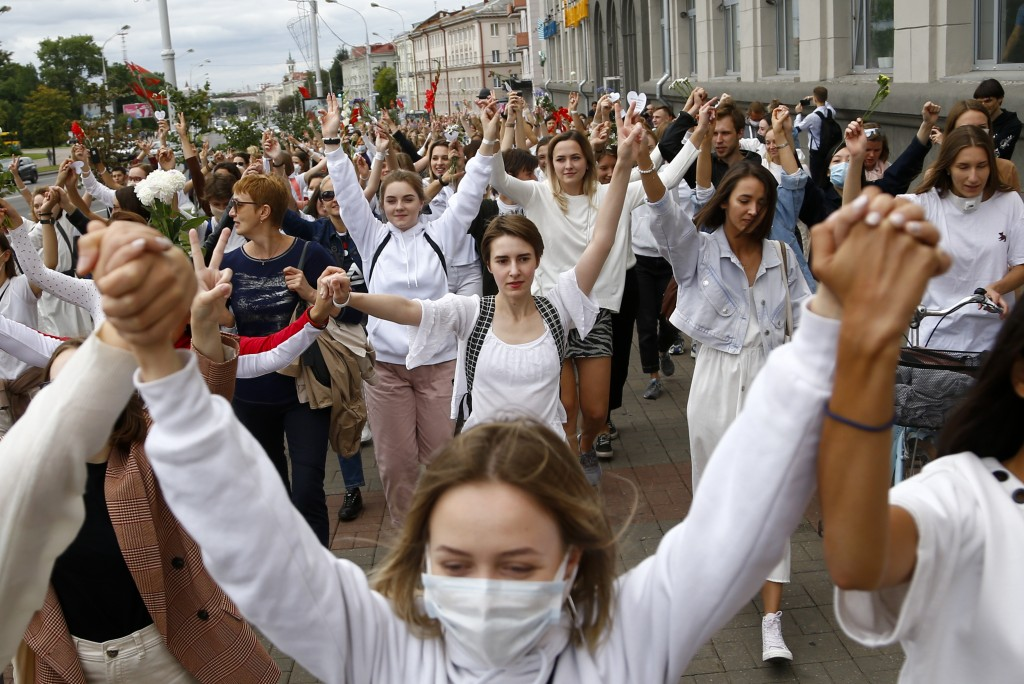 About 200 women march in solidarity with protesters injured in the latest rallies against the results of the country's presidential election in Minsk,...