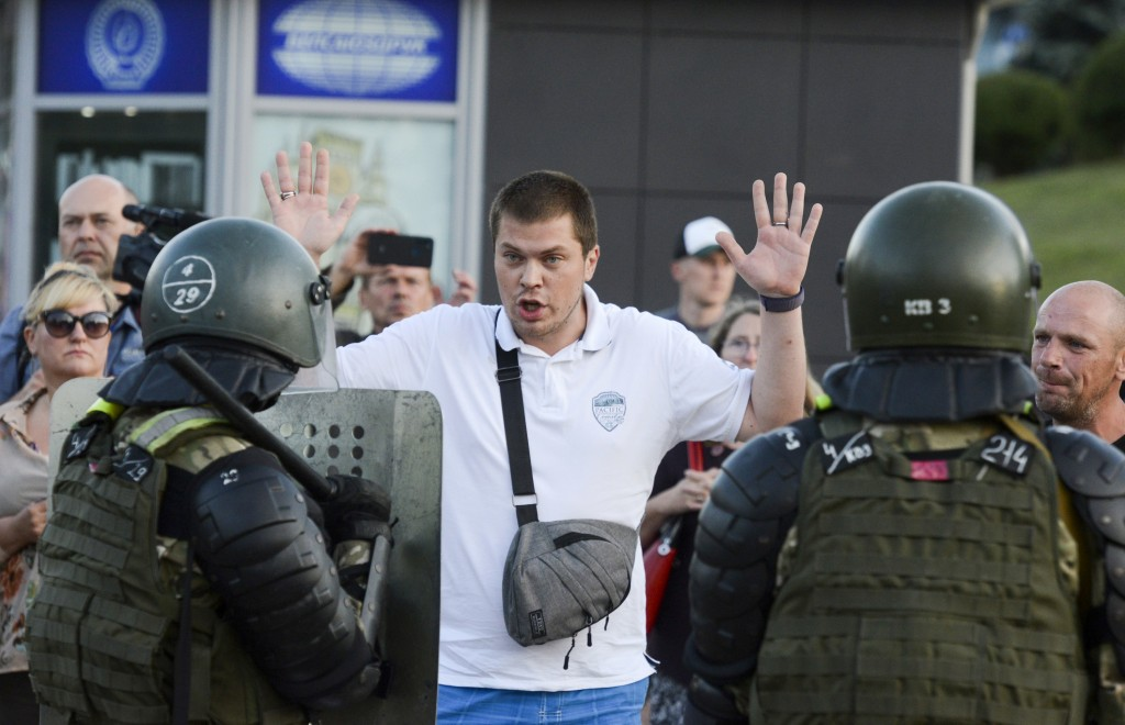 Police detain an opposition supporter protesting the election results as protesters encounter aggressive police tactics in the capital of Minsk, Belar...
