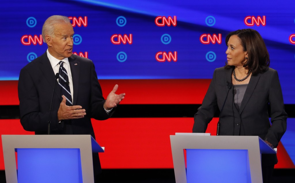 FILE - In this July 31, 2019, file photo, then-Democratic presidential candidate Sen. Kamala Harris, D-Calif., listens as Democratic presidential cand...