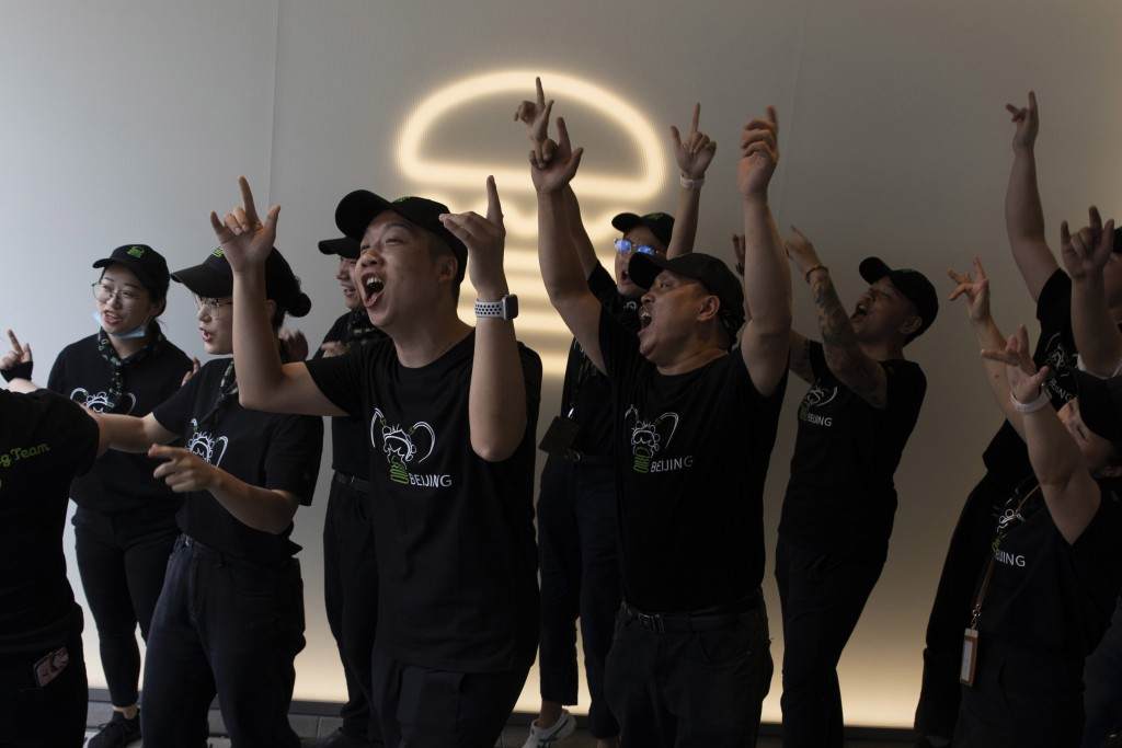 Workers practice their cheer before the opening of the first Beijing outlet for Shake Shack in Beijing Wednesday, Aug. 12, 2020. The U.S. headquartere...