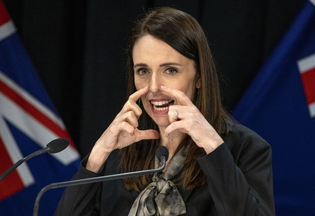 New Zealand Prime Minister Jacinda Ardern gestures during a press conference in Wellington, New Zealand, Wednesday, Aug. 12, 2020. Authorities have fo...