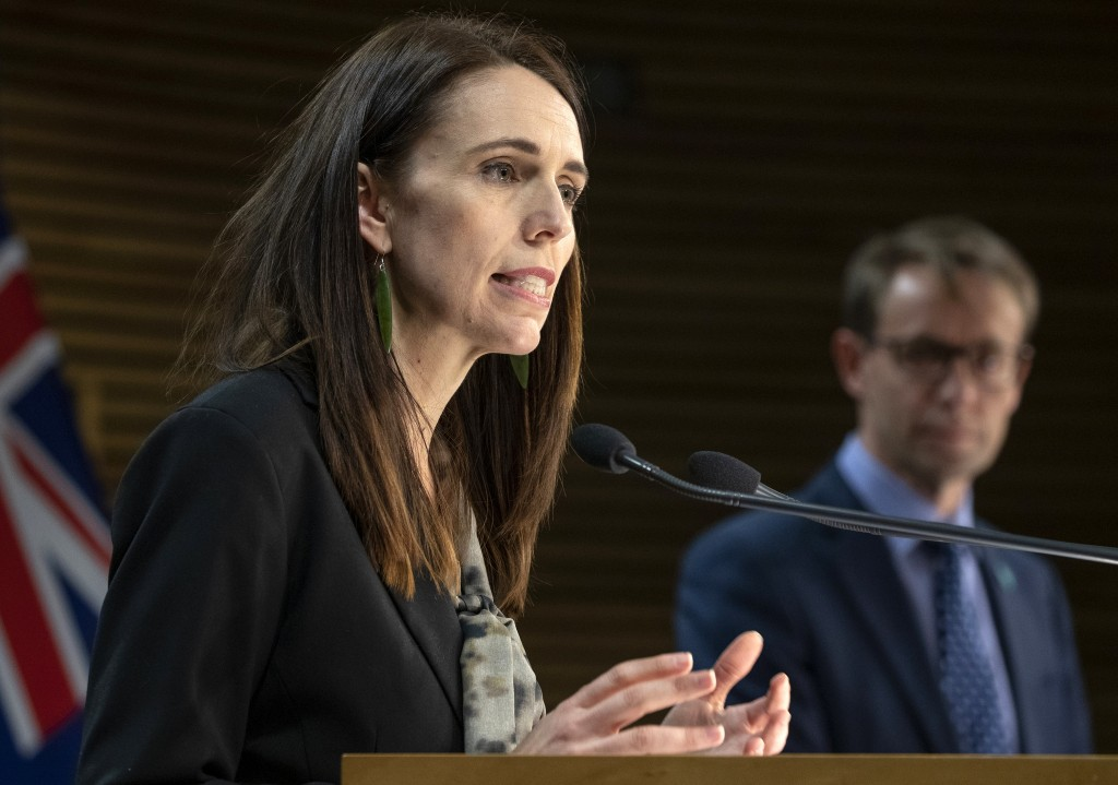New Zealand Prime Minister Jacinda Ardern, left, and Director of Health Ashley Bloomfield address a press conference in Wellington, New Zealand, Wedne...