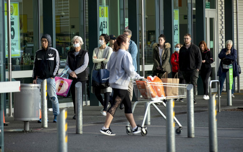 People queue early morning outside a supermarket in Hobsonville, Auckland as New Zealand prepares to move into Covid-19 Alert Level 3, Wednesday, Aug....