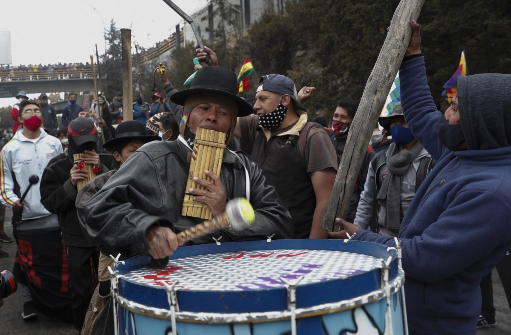 Musicians play during a protest against the postponement of the presidential election, in El Alto, Bolivia, Tuesday, Aug. 11, 2020. Citing the ongoing...