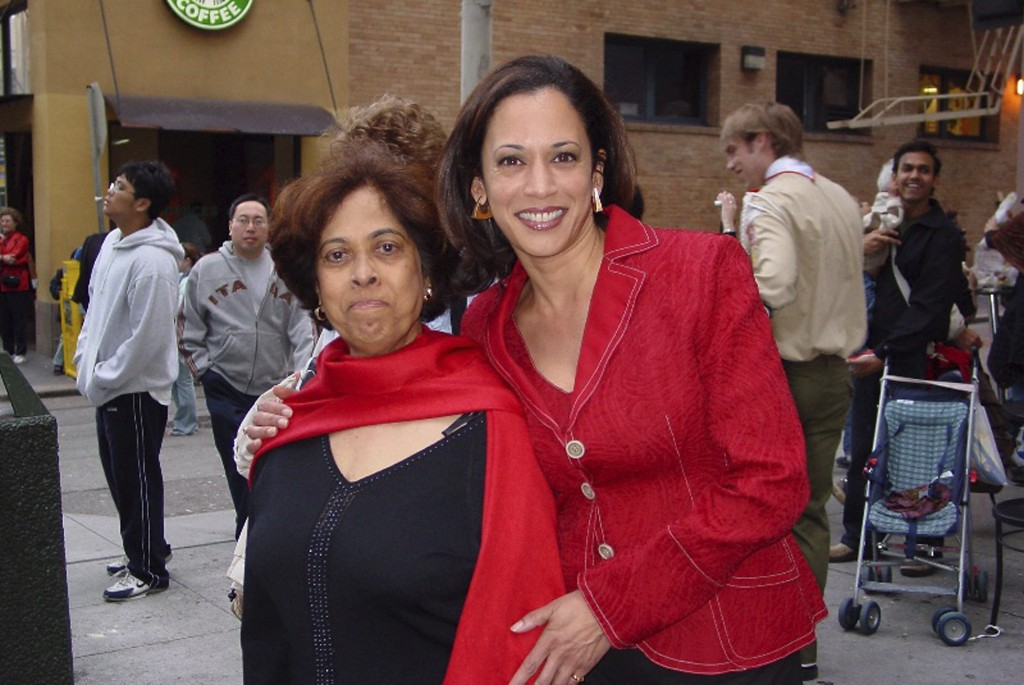 This 2007 photo provided by the Kamala Harris campaign shows her with her mother, Shyamala, at a Chinese New Year parade. (Kamala Harris campaign via ...